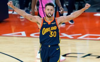 SAN FRANCISCO, CALIFORNIA - FEBRUARY 17: Stephen Curry #30 of the Golden State Warriors celebrates after making a three-point shot against the Miami Heat during overtime of an NBA basketball game at Chase Center on February 17, 2021 in San Francisco, California. NOTE TO USER: User expressly acknowledges and agrees that, by downloading and or using this photograph, User is consenting to the terms and conditions of the Getty Images License Agreement. (Photo by Thearon W. Henderson/Getty Images)