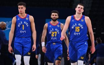 DENVER, CO - FEBRUARY 12: Michael Porter Jr. #1, Jamal Murray #27, and Nikola Jokic #15 of the Denver Nuggets look on during the game against the Oklahoma City Thunder on February 12, 2021 at the Ball Arena in Denver, Colorado. NOTE TO USER: User expressly acknowledges and agrees that, by downloading and/or using this Photograph, user is consenting to the terms and conditions of the Getty Images License Agreement. Mandatory Copyright Notice: Copyright 2021 NBAE (Photo by Bart Young/NBAE via Getty Images)