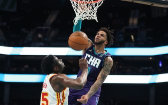 CHARLOTTE, NC - APRIL 11: (EDITOR'S NOTE: Dunk sequence three of three.) Miles Bridges #0 of the Charlotte Hornets dunks the ball during the game against the Atlanta Hawks on April 11, 2021 at Spectrum Center in Charlotte, North Carolina. NOTE TO USER: User expressly acknowledges and agrees that, by downloading and or using this photograph, User is consenting to the terms and conditions of the Getty Images License Agreement.  Mandatory Copyright Notice:  Copyright 2021 NBAE (Photo by Brock Williams-Smith/NBAE via Getty Images)