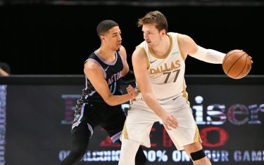 DALLAS, TX - APRIL 18: Luka Doncic #77 of the Dallas Mavericks dribbles the ball during the game against the Sacramento Kings on April 18, 2021 at the American Airlines Center in Dallas, Texas. NOTE TO USER: User expressly acknowledges and agrees that, by downloading and or using this photograph, User is consenting to the terms and conditions of the Getty Images License Agreement. Mandatory Copyright Notice: Copyright 2021 NBAE (Photo by Glenn James/NBAE via Getty Images)