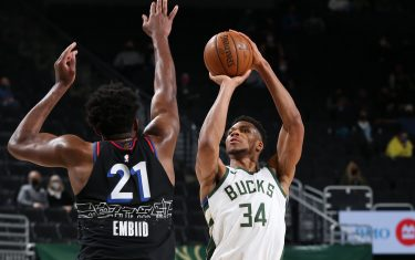 MILWAUKEE, WI - APRIL 22: Giannis Antetokounmpo #34 of the Milwaukee Bucks shoots the ball against the Philadelphia 76ers on April 22, 2021at the Fiserv Forum Center in Milwaukee, Wisconsin. NOTE TO USER: User expressly acknowledges and agrees that, by downloading and or using this Photograph, user is consenting to the terms and conditions of the Getty Images License Agreement. Mandatory Copyright Notice: Copyright 2021 NBAE (Photo by Gary Dineen/NBAE via Getty Images).