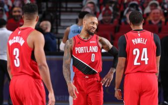 PORTLAND, OR - APRIL 23: Damian Lillard #0 of the Portland Trail Blazers smiles during the game against the Memphis Grizzlies on April 23, 2021 at the Moda Center Arena in Portland, Oregon. NOTE TO USER: User expressly acknowledges and agrees that, by downloading and or using this photograph, user is consenting to the terms and conditions of the Getty Images License Agreement. Mandatory Copyright Notice: Copyright 2021 NBAE (Photo by Sam Forencich/NBAE via Getty Images)