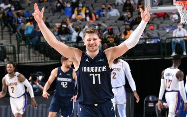 DALLAS, TX - APRIL 24: Luka Doncic #77 of the Dallas Mavericks celebrates during the game against the Los Angeles Lakers on April 24, 2021 at the American Airlines Center in Dallas, Texas. NOTE TO USER: User expressly acknowledges and agrees that, by downloading and or using this photograph, User is consenting to the terms and conditions of the Getty Images License Agreement. Mandatory Copyright Notice: Copyright 2021 NBAE (Photo by Glenn James/NBAE via Getty Images)