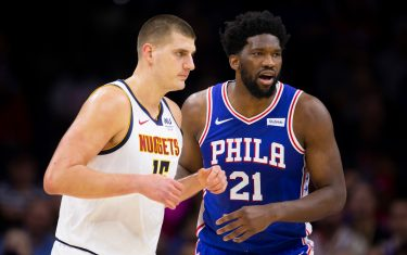 PHILADELPHIA, PA - DECEMBER 10: Joel Embiid #21 of the Philadelphia 76ers guards Nikola Jokic #15 of the Denver Nuggets in the first quarter at the Wells Fargo Center on December 10, 2019 in Philadelphia, Pennsylvania. The 76ers defeated the Nuggets 97-92. NOTE TO USER: User expressly acknowledges and agrees that, by downloading and/or using this photograph, user is consenting to the terms and conditions of the Getty Images License Agreement. (Photo by Mitchell Leff/Getty Images)