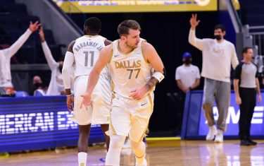 SAN FRANCISCO, CA - APRIL 27: Luka Doncic #77 of the Dallas Mavericks reacts to a play during the game against the Golden State Warriors on April 27, 2021 at Chase Center in San Francisco, California. NOTE TO USER: User expressly acknowledges and agrees that, by downloading and or using this photograph, user is consenting to the terms and conditions of Getty Images License Agreement. Mandatory Copyright Notice: Copyright 2021 NBAE (Photo by Noah Graham/NBAE via Getty Images)
