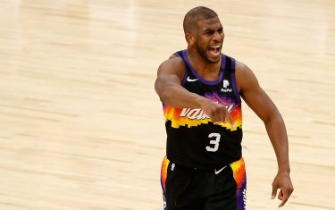 PHOENIX, ARIZONA - APRIL 07: Chris Paul #3 of the Phoenix Suns reacts during the second half of the NBA game against the Utah Jazz at Phoenix Suns Arena on April 07, 2021 in Phoenix, Arizona. The Suns defeated the Jazz 117-113 in overtime.  NOTE TO USER: User expressly acknowledges and agrees that, by downloading and or using this photograph, User is consenting to the terms and conditions of the Getty Images License Agreement. (Photo by Christian Petersen/Getty Images)