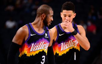 PHOENIX, AZ - FEBRUARY 7: Chris Paul #3 talks with Devin Booker #1 of the Phoenix Suns during the game against the Boston Celtics on February 7, 2021 at Talking Stick Resort Arena in Phoenix, Arizona. NOTE TO USER: User expressly acknowledges and agrees that, by downloading and or using this photograph, user is consenting to the terms and conditions of the Getty Images License Agreement. Mandatory Copyright Notice: Copyright 2021 NBAE (Photo by Barry Gossage/NBAE via Getty Images)