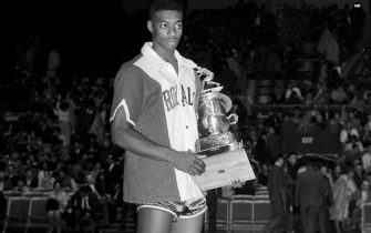 SYRACUSE, NY - 1961: Oscar Robertson #14 of the Cincinnati Royals is awarded the 1961 NBA All-Star MVP Trophy after the 1961 NBA All-Star Game circa 1961 in Syracuse, New York. NOTE TO USER: User expressly acknowledges and agrees that, by downloading and or using this photograph, User is consenting to the terms and conditions of the Getty Images License Agreement. Mandatory Copyright Notice: Copyright 1961 NBAE (Photo by The Stevenson Collection/NBAE via Getty Images)