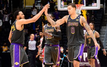 LOS ANGELES, CA - MAY 12: Talen Horton-Tucker #5 of the Los Angeles Lakers high fives Kyle Kuzma #0 of the Los Angeles Lakers during the game against the Houston Rockets on May 12, 2021 at STAPLES Center in Los Angeles, California. NOTE TO USER: User expressly acknowledges and agrees that, by downloading and/or using this Photograph, user is consenting to the terms and conditions of the Getty Images License Agreement. Mandatory Copyright Notice: Copyright 2021 NBAE (Photo by Adam Pantozzi/NBAE via Getty Images)
