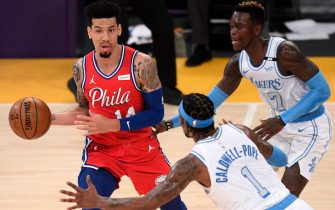 LOS ANGELES, CALIFORNIA - MARCH 25: Danny Green #14 of the Philadelphia 76ers looks to pass as he is guarded by Dennis Schroder #17 and Kentavious Caldwell-Pope #1 of the Los Angeles Lakers during the second quarter at Staples Center on March 25, 2021 in Los Angeles, California.  (Photo by Harry How/Getty Images)  NOTE TO USER: User expressly acknowledges and agrees that, by downloading and or using this photograph, User is consenting to the terms and conditions of the Getty Images License Agreement.