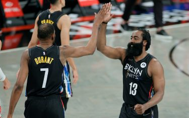 NEW YORK, NEW YORK - MAY 15: James Harden #13 high-fives Kevin Durant #7 of the Brooklyn Nets during the second half against the Chicago Bulls at Barclays Center on May 15, 2021 in the Brooklyn borough of New York City. The Nets won 105-91. NOTE TO USER: User expressly acknowledges and agrees that, by downloading and or using this photograph, User is consenting to the terms and conditions of the Getty Images License Agreement. (Photo by Sarah Stier/Getty Images)