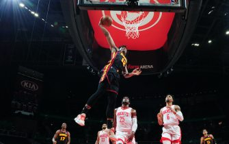 ATLANTA, GA - MAY 16: De'Andre Hunter #12 of the Atlanta Hawks dunks the ball during the game against the Houston Rockets on May 16, 2021 at State Farm Arena in Atlanta, Georgia.  NOTE TO USER: User expressly acknowledges and agrees that, by downloading and/or using this Photograph, user is consenting to the terms and conditions of the Getty Images License Agreement. Mandatory Copyright Notice: Copyright 2021 NBAE (Photo by Scott Cunningham/NBAE via Getty Images)