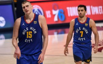 """DENVER, CO - MAY 22: Nikola Jokic (15) of the Denver Nuggets and Facundo Campazzo (7) walk off the court after the fourth quarter of the Portland Trail Blazers""""u2019 123-109 win at Ball Arena on Saturday, May 22, 2021. (Photo by AAron Ontiveroz/The Denver Post)"""