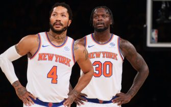 NEW YORK, NY - MAY 23: Derrick Rose #4 and Julius Randle #30 of the New York Knicks look on during Round 1, Game 1 of the 2021 NBA Playoffs on May 23, 2021 at Madison Square Garden in New York City, New York.  NOTE TO USER: User expressly acknowledges and agrees that, by downloading and or using this photograph, User is consenting to the terms and conditions of the Getty Images License Agreement. Mandatory Copyright Notice: Copyright 2021 NBAE  (Photo by Nathaniel S. Butler/NBAE via Getty Images)