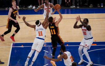 NEW YORK, NY - MAY 23: Atlanta Hawks' Trae Young (11) hits the go-ahead basket near the end of Game 1 of an NBA basketball first-round playoff series against the New York Knicks on May 23, 2021 in New York City. The Hawks defeated the Knicks 107-105. NOTE TO USER: User expressly acknowledges and agrees that,  by downloading and or using this photograph,  User is consenting to the terms and conditions of the Getty Images License Agreement. (Photo by Seth Wenig - Pool/Getty Images)