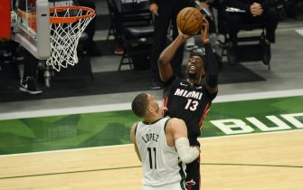 MILWAUKEE, WISCONSIN - MAY 24:  Bam Adebayo #13 of the Miami Heat shoots against Brook Lopez #11 of the Milwaukee Bucks in the first quarter during Game Two of their Eastern Conference first-round playoff series between the Milwaukee Bucks and the Miami Heat at Fiserv Forum on May 24, 2021 in Milwaukee, Wisconsin.  NOTE TO USER: User expressly acknowledges and agrees that, by downloading and or using this photograph, User is consenting to the terms and conditions of the Getty Images License Agreement. (Photo by Quinn Harris/Getty Images)