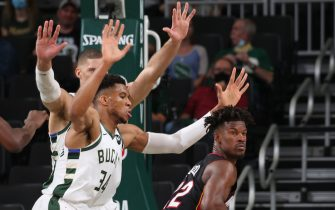 MILWAUKEE, WI - MAY 24: Giannis Antetokounmpo #34 of the Milwaukee Bucks plays defense on Jimmy Butler #22 of the Miami Heat during Round 1, Game 2 of the 2021 NBA Playoffs on May 24, 2021 at the Fiserv Forum Center in Milwaukee, Wisconsin. NOTE TO USER: User expressly acknowledges and agrees that, by downloading and or using this Photograph, user is consenting to the terms and conditions of the Getty Images License Agreement. Mandatory Copyright Notice: Copyright 2021 NBAE (Photo by Gary Dineen/NBAE via Getty Images).