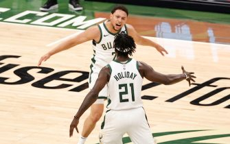 MILWAUKEE, WI - MAY 24: Bryn Forbes #7 and Jrue Holiday #21 of the Milwaukee Bucks celebrate during the game against the Miami Heat during Round 1, Game 2 of the 2021 NBA Playoffs on May 24, 2021 at the Fiserv Forum Center in Milwaukee, Wisconsin. NOTE TO USER: User expressly acknowledges and agrees that, by downloading and or using this Photograph, user is consenting to the terms and conditions of the Getty Images License Agreement. Mandatory Copyright Notice: Copyright 2021 NBAE (Photo by Kamil Krzaczynski/NBAE via Getty Images).