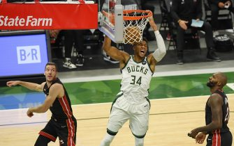 MILWAUKEE, WISCONSIN - MAY 24:  Giannis Antetokounmpo #34 of the Milwaukee Bucks dunks in the third quarter against the Miami Heat during Game Two of their Eastern Conference first-round playoff series between the Milwaukee Bucks and the Miami Heat at Fiserv Forum on May 24, 2021 in Milwaukee, Wisconsin.  NOTE TO USER: User expressly acknowledges and agrees that, by downloading and or using this photograph, User is consenting to the terms and conditions of the Getty Images License Agreement. (Photo by Quinn Harris/Getty Images)