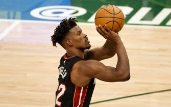 MILWAUKEE, WI - MAY 24: Jimmy Butler #22 of the Miami Heat shoots the ball during the game against the Milwaukee Bucks during Round 1, Game 2 of the 2021 NBA Playoffs on May 24, 2021 at the Fiserv Forum Center in Milwaukee, Wisconsin. NOTE TO USER: User expressly acknowledges and agrees that, by downloading and or using this Photograph, user is consenting to the terms and conditions of the Getty Images License Agreement. Mandatory Copyright Notice: Copyright 2021 NBAE (Photo by Kamil Krzaczynski/NBAE via Getty Images).