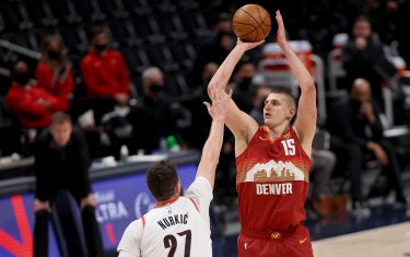 DENVER, COLORADO - MAY 24: Nikola Jokic #15 of the Denver Nuggets puts up a shot over Jusuf Nurkic #27 of the Portland Trail Blazers in the second quarter during Game Two of their Western Conference first-round playoff series at Ball Arena on May 24, 2021 in Denver, Colorado. NOTE TO USER: User expressly acknowledges and agrees that, by downloading and or using this photograph, User is consenting to the terms and conditions of the Getty Images License Agreement. (Photo by Matthew Stockman/Getty Images)