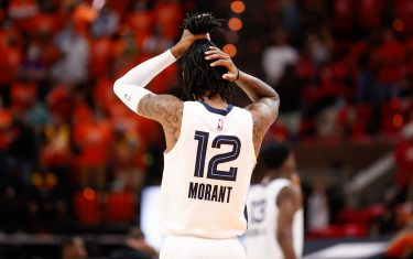 SALT LAKE CITY, UT - MAY 26: Ja Morant #12 of the Memphis Grizzlies fixes his hair before the game against the Utah Jazz during Round 1, Game 2 of the 2021 NBA Playoffs on May 26, 2021 at vivint.SmartHome Arena in Salt Lake City, Utah. NOTE TO USER: User expressly acknowledges and agrees that, by downloading and or using this Photograph, User is consenting to the terms and conditions of the Getty Images License Agreement. Mandatory Copyright Notice: Copyright 2021 NBAE (Photo by Jeff Swinger/NBAE via Getty Images)