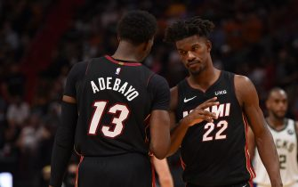 MIAMI, FL - MAY 29: Bam Adebayo #13 of the Miami Heat and Jimmy Butler #22 of the Miami Heat high-five during a game against the Milwaukee Bucks during Round One Game Four of the Eastern Conference Playoffs on May 29, 2021 at AmericanAirlines Arena in Miami, Florida. NOTE TO USER: User expressly acknowledges and agrees that, by downloading and/or using this Photograph, user is consenting to the terms and conditions of the Getty Images License Agreement. Mandatory Copyright Notice: Copyright 2021 NBAE (Photo by David Dow/NBAE via Getty Images)