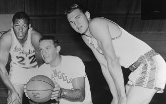 (Original Caption) Left to right: Elgin Baylor, Coach Fred Schaus and Jerry West of the Los Angeles Lakers.