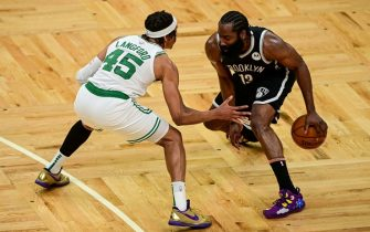 BOSTON, MASSACHUSETTS - MAY 30: James Harden #13 of the Brooklyn Nets handles the ball against Romeo Langford #45 of the Boston Celtics during Game Four of the Eastern Conference first round series at TD Garden on May 30, 2021 in Boston, Massachusetts. NOTE TO USER: User expressly acknowledges and agrees that, by downloading and or using this photograph, User is consenting to the terms and conditions of the Getty Images License Agreement. (Photo by Maddie Malhotra/Getty Images)