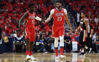 NEW ORLEANS, LA - APRIL 21:  Anthony Davis #23 of the New Orleans Pelicans congratulates Jrue Holiday #11 during Game Four of the first round of the Western Conference playoffs against the Portland Trail Blazers at the Smoothie King Center on April 21, 2018 in New Orleans, Louisiana.  The Pelicans defeated the Trail Blazers 131-123 to sweep the series 4-0.  NOTE TO USER: User expressly acknowledges and agrees that, by downloading and or using this photograph, User is consenting to the terms and conditions of the Getty Images License Agreement.  (Photo by Stacy Revere/Getty Images)