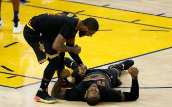 Cleveland Cavaliers' Kyrie Irving (2) pretends to punch Cleveland Cavaliers' LeBron James (23) in the chest after James made a basket and was fouled by Golden State Warriors' Brandon Rush (4) in the fourth quarter of Game 5 of the NBA Finals at Oracle Arena in Oakland, Calif., on Monday, June 13, 2016. (Nhat V. Meyer/Bay Area News Group) (Photo by MediaNews Group/Bay Area News via Getty Images)
