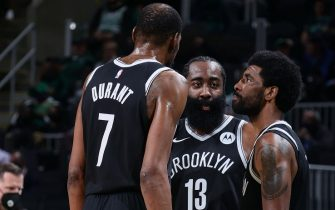 BOSTON, MA - MAY 30: James Harden #13 talks with Kevin Durant #7 and Kyrie Irving #11 of the Brooklyn Nets during the game against the Boston Celtics during Round 1, Game 4 of the 2021 NBA Playoffs on May 30, 2021 at the TD Garden in Boston, Massachusetts.  NOTE TO USER: User expressly acknowledges and agrees that, by downloading and or using this photograph, User is consenting to the terms and conditions of the Getty Images License Agreement. Mandatory Copyright Notice: Copyright 2021 NBAE  (Photo by Nathaniel S. Butler/NBAE via Getty Images)