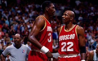 SAN ANTONIO - MAY 30:  Clyde Drexler #22 talks to Hakeem Olajuwon #34 of the Houston Rockets in Game Five of the Western Conference Finals during the 1995 NBA Playoffs at the Alamodome on May 30, 1995 in San Antonio. The Houston Rockets defeated the San Antonio Spurs 111-90.  NOTE TO USER: User expressly acknowledges and agrees that, by downloading and or using this photograph, User is consenting to the terms and conditions of the Getty Images License Agreement. Mandatory Copyright Notice: Copyright 1995 NBAE (Photo by Andrew D. Bernstein/NBAE via Getty Images)