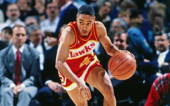 LANDOVER - 1990: Spud Webb #4 of the Atlanta Hawks dribbles against the Washington Bullets during a game played circa 1990 at the Capitol Center in Landover, Maryland. NOTE TO USER: User expressly acknowledges and agrees that, by downloading and or using this photograph, User is consenting to the terms and conditions of the Getty Images License Agreement. Mandatory Copyright Notice: Copyright 1990 NBAE (Photo by Scott Cunningham/NBAE via Getty Images)