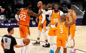 PHOENIX, ARIZONA - APRIL 02: Jae Crowder #99 of the Phoenix Suns high fives Deandre Ayton #22, Chris Paul #3, Devin Booker #1 and Jevon Carter #4 after drawing a foul on a three-point shot during the first half of the NBA game against the Oklahoma City Thunder at Phoenix Suns Arena on April 02, 2021 in Phoenix, Arizona.  NOTE TO USER: User expressly acknowledges and agrees that, by downloading and or using this photograph, User is consenting to the terms and conditions of the Getty Images License Agreement. (Photo by Christian Petersen/Getty Images)