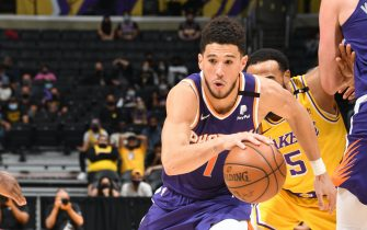 LOS ANGELES, CA - JUNE 3: Devin Booker #1 of the Phoenix Suns drives to the basket against the Los Angeles Lakers during Round 1, Game 6 of the 2021 NBA Playoffs on June 3, 2021 at STAPLES Center in Los Angeles, California. NOTE TO USER: User expressly acknowledges and agrees that, by downloading and/or using this Photograph, user is consenting to the terms and conditions of the Getty Images License Agreement. Mandatory Copyright Notice: Copyright 2021 NBAE (Photo by Andrew D. Bernstein/NBAE via Getty Images)