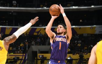 LOS ANGELES, CA - JUNE 3: Devin Booker #1 of the Phoenix Suns shoots the ball against the Los Angeles Lakers during Round 1, Game 6 of the 2021 NBA Playoffs on June 3, 2021 at STAPLES Center in Los Angeles, California. NOTE TO USER: User expressly acknowledges and agrees that, by downloading and/or using this Photograph, user is consenting to the terms and conditions of the Getty Images License Agreement. Mandatory Copyright Notice: Copyright 2021 NBAE (Photo by Andrew D. Bernstein/NBAE via Getty Images)