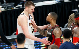 PORTLAND, OREGON - JUNE 03: Nikola Jokic #15 of the Denver Nuggets and Damian Lillard #0 of the Portland Trail Blazers shake hands after the Denver Nuggets beat the Portland Trail Blazers 126-115  Round 1, Game 6 of the 2021 NBA Playoffs at Moda Center on June 03, 2021 in Portland, Oregon. NOTE TO USER: User expressly acknowledges and agrees that, by downloading and or using this photograph, User is consenting to the terms and conditions of the Getty Images License Agreement. (Photo by Steph Chambers/Getty Images)