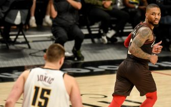 """PORTLAND, OR - JUNE 3: Damian Lillard (0) of the Portland Trail Blazers looks back over his shoulder at Nikola Jokic (15) of the Denver Nuggets after a missed layup against the Denver big man during the fourth quarter of Denver""""u2019s series-clinching 126-115 win at Moda Center on Thursday, June 3, 2021. The Denver Nuggets defeated the Portland Trail Blazers 4-2 in their best-of-seven first round NBA Playoffs series. (Photo by AAron Ontiveroz/MediaNews Group/The Denver Post via Getty Images)"""