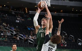 MILWAUKEE, WI - MAY 2: Brook Lopez #11 of the Milwaukee Bucks shoots the ball during the game against the Brooklyn Nets on May 2, 2021 at the Fiserv Forum Center in Milwaukee, Wisconsin. NOTE TO USER: User expressly acknowledges and agrees that, by downloading and or using this Photograph, user is consenting to the terms and conditions of the Getty Images License Agreement. Mandatory Copyright Notice: Copyright 2021 NBAE (Photo by Gary Dineen/NBAE via Getty Images).