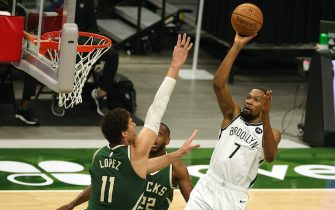 MILWAUKEE, WISCONSIN - MAY 02: Kevin Durant #7 of the Brooklyn Nets shoots over Brook Lopez #11 of the Milwaukee Bucks during the first half of a game at Fiserv Forum on May 02, 2021 in Milwaukee, Wisconsin. NOTE TO USER: User expressly acknowledges and agrees that, by downloading and or using this photograph, User is consenting to the terms and conditions of the Getty Images License Agreement. (Photo by Stacy Revere/Getty Images)
