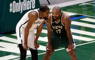 MILWAUKEE, WI - MAY 2: Kevin Durant #7 of the Brooklyn Nets talks with P.J. Tucker #17 of the Milwaukee Bucks during the game on May 2, 2021 at the Fiserv Forum Center in Milwaukee, Wisconsin. NOTE TO USER: User expressly acknowledges and agrees that, by downloading and or using this Photograph, user is consenting to the terms and conditions of the Getty Images License Agreement. Mandatory Copyright Notice: Copyright 2021 NBAE (Photo by Kamil Krzaczynski/NBAE via Getty Images).