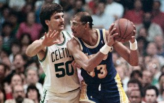 (Original Caption) 6/7/1987-Boston, MA- Celtics', Greg Kite(left), guards Laker's, Kareem Abdul-Jabbar, closely in the 3rd quarter of the 3rd game, in the NBA Finals at the Boston Garden.