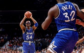 CHICAGO - MAY 12:  Shaquille O'Neal #32 of the Orlando Magic is thrown a pass by teammate Horace Grant #54 during Game Three of the 1995 Easter Conference Semi-Finals against the Chicago Bulls at the United Center on May 12, 1995 in Chicago, Illinois.  NOTE TO USER: User expressly acknowledges that, by downloading and or using this photograph, User is consenting to the terms and conditions of the Getty Images License agreement. Mandatory Copyright Notice: Copyright 1995 NBAE (Photo by Barry Gossage/NBAE via Getty Images)