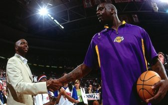 AUBURN HILLS, MI - JUNE 10:  Shaquille O'Neal #34 of the Los Angeles Lakers, right, shakes hands with John Salley prior to the game against the Detroit Pistons during Game three of the 2004 NBA Finals at the Palace of Auburn Hills on June 10, 2004 in Auburn Hills, Michigan.  NOTE TO USER: User expressly acknowledges and agrees that, by downloading and/or using this Photograph, user is consenting to the terms and conditions of the Getty Images License Agreement.  Mandatory Copyright Notice: Copyright 2004 NBAE (Photo by Andrew D. Bernstein/NBAE via Getty Images)