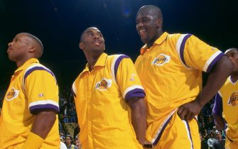 INGLEWOOD, CA - DECEMBER 13:  Byron Scott #4, Kobe Bryant #8 and Shaquille O'Neal #34 of the Los Angeles Lakers before the game against the Portland Trail Blazers at the Great Western Forum on December 13,1996 in Inglewood, California. NOTE TO USER: User expressly acknowledges and agrees that, by downloading and or using this photograph, User is consenting to the terms and conditions of the Getty Images License Agreement. Mandatory Copyright Notice: Copyright 1996 NBAE (Photo by Andrew D. Bernstein/NBAE via Getty Images)
