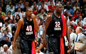 MIAMI - APRIL 6:  Shaquille O'Neal #32 of the Miami Heat walks with his teammate Udonis Haslem #40 during the game against the Detroit Pistons on April 6, 2006 at American Airlines Arena in Miami, Florida. The Pistons won 95-82.  NOTE TO USER: User expressly acknowledges and agrees that, by downloading and/or using this Photograph, User is consenting to the terms and conditions of the Getty Images License Agreement. Mandatory Copyright Notice: Copyright 2006 NBAE (Photo by Issac Baldizon/NBAE via Getty Images) *** Local Caption *** Shaquille O'Neal;Udonis Haslem