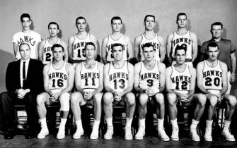 ST.LOUIS - 1958: The World Champions of basketball ST.Louis Hawks  pose for a team portrait in 1958 starting in the front row (L-R):  Head Coach Alex Hannum, Cliff Hagan, Jack Coleman, captain Charley Share, Bob Pettit, Walt Davis, Ed Macauley. back row: Max Shapiro, ball boy; Slater Martin, Win Wilfona, Jack McMahon, Med Park, Frank Selvy, Trainer Bernie Ebert in St.Louis, Missouri. NOTE TO USER: User expressly acknowledges  and agrees that, by downloading and or using this  photograph, User is consenting to the terms and conditions of the Getty Images License Agreement. Mandatory copyright notice: Copyright NBAE 2002 (Photo by NBAPhotos/ NBAE/ Getty Images)