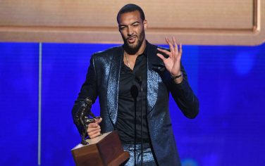 SANTA MONICA, CALIFORNIA - JUNE 24: Rudy Gobert accepts the Kia NBA Defensive Player of the Year award onstage during the 2019 NBA Awards presented by Kia on TNT at Barker Hangar on June 24, 2019 in Santa Monica, California. (Photo by Kevin Winter/Getty Images for Turner Sports)