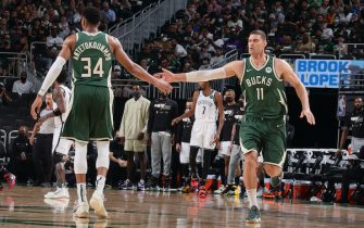 MILWAUKEE, WI - JUNE 10: Giannis Antetokounmpo #34 of the Milwaukee Bucks high fives Brook Lopez #11 of the Milwaukee Bucks during Round 2, Game 2 of the 2021 NBA Playoffs on June 10, 2021 at the Fiserv Forum Center in Milwaukee, Wisconsin. NOTE TO USER: User expressly acknowledges and agrees that, by downloading and or using this Photograph, user is consenting to the terms and conditions of the Getty Images License Agreement. Mandatory Copyright Notice: Copyright 2021 NBAE (Photo by Nathaniel S. Butler/NBAE via Getty Images).